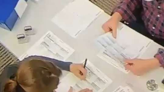 Election volunteer spotted filling out ballots
